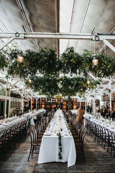 modern warehouse wedding with hanging greenery