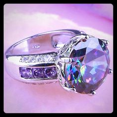 H.P.BNWT RAINBOW TOPAZ AMETHYST SILVER RING BNWT RAINBOW TOPAZ AMETHYST SILVER RING 14MM SIZE 8 THANK YOU TO @vanessa_03 FOR THIS HOST PICK FOR GIRLY GIRL Jewelry Rings