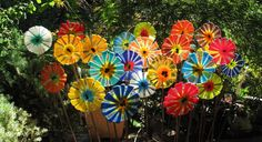Fused glass flowers on a copper coated steel stake.