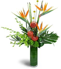 The finest tropical island has got nothing on our exotic Paradise Flight™ bouquet! Exotic birds of paradise flowers and luxurious stems of dendrobium orchids are playfully arranged with unique pincushion protea and more in a tall clear glass vase. Tropical Floral Arrangements, White Flower Arrangements, Vase Arrangements, Exotic Flowers, Tropical Flowers, Silk Flowers, Beautiful Flowers, Flowers Garden, Exotic Birds