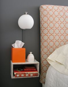 How to build floating night stands and lamps.  Very good tutorial, very easy to do; even if you have few tools and no skills.  I love the look of the lamps. (for me.. I'd put some decorative wood trim on the front of the night stand and skip the tacks.)