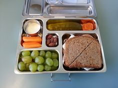 Today's PlanetBox Rover Lunch.  Turkey, Brie and Cranberry Sandwich, Green Grapes, Carrots and Dip, Dill Pickle and a few Roasted Almonds L | www.PlanetBox.com