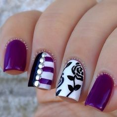 Purple with white and black flowers and stripes on accent nails