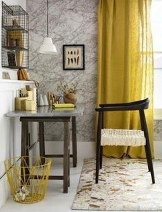 yellow linen curtains cast a rich golden glow and dark wood furniture adds depth and drama to this home office