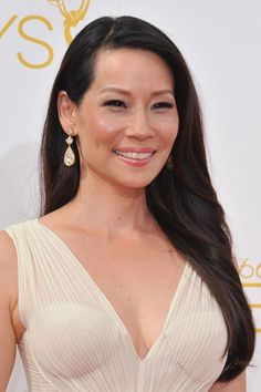 "#2: Dainty Straight Hair in Side-Swept Downdo ""Good morning. Charlie!"" Do you still remember her as one of the sexy members of Charlie's Angels? Lucy Liu is of Chinese descent, and she is among the most beautiful Hollywood faces. Her signature looks are always simple but very classy. The Asian hairstyle she wore to the 66th Primetime Emmy Awards proves it. Lucy rocked her straight flowing tresses side-parted and tucked behind the ear on one side."