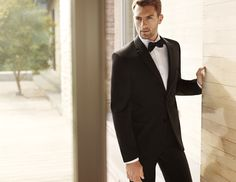 I like this tuxedo for the guys.  At Men's Wearhouse:  Vera Wang Two-Button Super 130s Grosgrain Notch Lapel