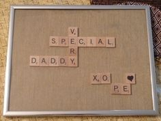 My oldest daughter and I made this for Father's Day ~ my husband is a huge Scrabble fan.  I saw a Scrabble game @ a yardsale and starting going through the tiles to make sure they were all there...but decided to make this instead.  The letters are glued onto a board, covered with fabric (leftover from the DR drapes I made).  And, no there isn't a tile w/a heart...thanks to my handy sharpie:>).  Needless to say, this gift is a HUGE hit and very treasured.  Happy tiling! Daddy Gifts, Fathers Day Gifts, Daddy Day, Personalized Gifts For Dad, Christmas Planning, Father Daughter, Creative Crafts, Sharpie, So Little Time