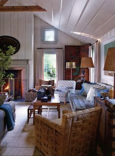 BLUE HEAVEN, the Sag Harbor home of designer Steven Gambrel. the 3 year project, expanding this area for entertianing. the wide plank pine floors, wide plank walls, vaulted beam ceilings. artfully arranged furniture, perfectly mixed antiques. range of detail blue fabrics, prints, patterns.  via:markdsikes.com