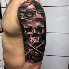 Real photo like black and white pirate style skull with bones and pyramid half sleeve tattoo
