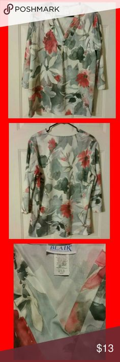 BEAUTIFUL   BLAIR  BLOUSE LIKE  NEW.  100%  POLYESTER .  AWESOME BRIGHT  ORANGE  FLOWER  DESIGN  WITH  GREEN  LEAFS.  &  WHITE   BACKGROUND.  HAS  PLEATS   IN  FRONT.  3/4   SLEEVES,  SO  VERY  SOFT. BLAIR Tops Blouses