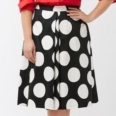 Polka Dot Midi Skirt Black and white oversized polka dot midi length skirt with front box pleat and hidden back zipper closure. A-line silhouette. Cotton / Poly / Spandex fabrication- slight stretch for comfort. Brand new- never worn. No trades. Lane Bryant Skirts Midi