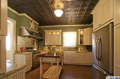 Dreamy Kitchen...Love the colors and especially that pressed tin ceiling.. This is so me already!