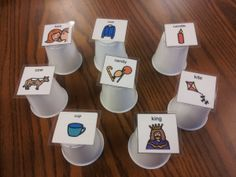 "speech therapy activity for a question asking goal: Hide a preferred item under a cup - student asks,""Is it under the ____?""  Supplies: Mini cups, printer"