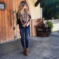 Brighton the day styling jeans, booties, black sweater, brown plaid scarf
