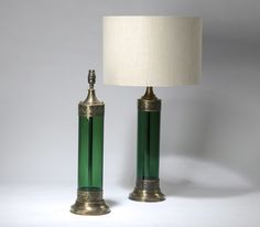 pair of medium green glass tube lamps with gilt metal mounts