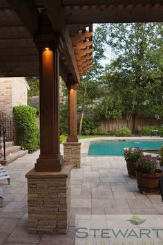 Add a little shade and height to your backyard with a patio covering or pavilion. #StewartLandDesigns