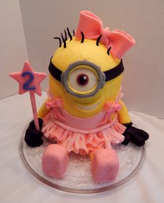 Bella's Ballerina Minion! A 6 inch Minion complete with what every adorable lil girl needs, a tu-tu!! All candy clay and buttercream, no fondant!!  https://www.facebook.com/angelas.cakes2011