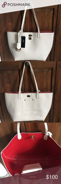 BCBG Cream & Red Tote NWT BCBG Cream & Red tote. Brand spankin' new. No marks, scuffs or wear. Gorgeous tote bag. Can fit a laptop and much more! Cream with red interior. Gold lock clasp & gold and leather charm. Not sure if faux leather or real leather. OFFERS WELCOMED. BCBG Bags Totes