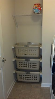 Smart & simple laundry storage. Maybe for bathroom sort dirty clothes