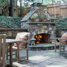 Nice fireplace on patio added to retaining wall