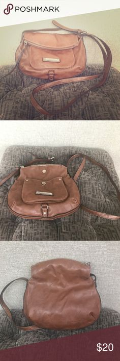 Nine West cross body bag! Small Nine West cross body bag! Classic brown circular bag! Cute fold over top with magnetic clip and small pocket in front! In perfect condition barely used! Soft man made material great for a summer outfit! Nine West Bags Crossbody Bags