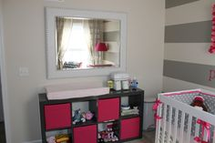 This changing table idea is genius.  IKEA Expedite shelving unit.  Had planned to put something like this in the closet, but I think it's an interesting idea to make it the changer!