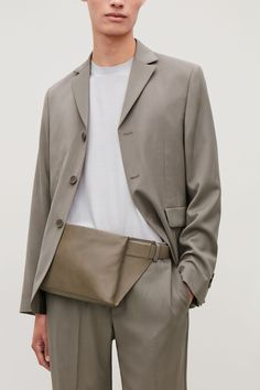 Made from smooth, buttery leather, this bag is a modern accessory designed to be worn across the body. Secured with a belt-style strap, it has a lined inside compartment, brushed silver-tone metal hardware and a zip fastening. Leather Laptop Bag, Leather Crossbody Bag, Crossbody Bags, Tote Bags, Bum Bags, Mens Modern Clothing, Grey Bags, Mens Leather Accessories, Vintage Backpacks