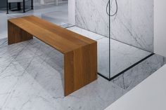 Suspended and floorstanding seats for the bathroom in Corian®, thermo-treated ash wood, Hemlock, lati and aluminium.