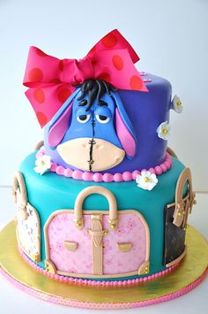 Eeyore Cake.  I'm not a fan of the purses on the bottom tier, but the Eeyore is so cute!