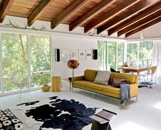 The main focal point is the huge window walls, and the secondary focal points are places like the wood ceiling or the couch area.