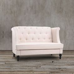 This unique wing back settee in cream beige color would work great in the living room, den, bedroom, or library.  It features gentle curves, in a sleek modern style.  Complete with a tufted back and turned legs in espresso.