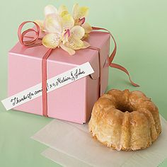 Mini Coconut-Macadamia Bundt Cakes - Flavored with toasted coconut, coconut milk, and chopped macadamia nuts, these buttery Bundt cakes make great wedding favors when packaged in individual gift boxes.