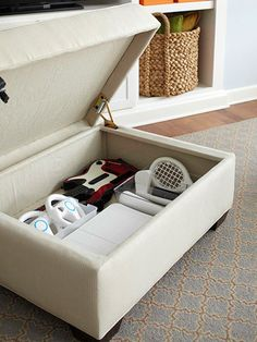 Storage Ottoman...  Today's popular video games often come with a host of bulky controllers, such as guitars, balance boards, or steering wheels. Look for a lidded ottoman with a slow-release hinge to stash these items out-of-sight. Or gather them in a large basket in the corner of the room.