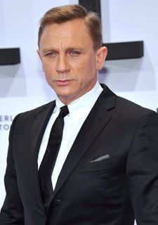 Daniel Craig: Worn in a sharp side parting with short sides and length on top, styled in a swept-over finish, this look is classic gents styling at its very best and a non-scary way for clients to tackle an on-trend look. Image courtesy of @HJ Interactive