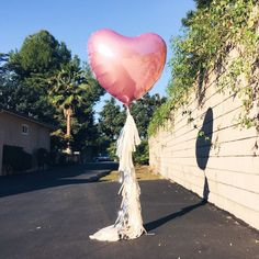 Foil Heart Tassel Balloon - Valentine's Day - Jumbo mylar heart balloon with tassel garland - Red Pink or Lavender by OhShinyPaperCo on Etsy https://www.etsy.com/listing/217659782/foil-heart-tassel-balloon-valentines-day