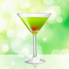 Japanese Slipper made with MIDORI. My new favorite drink! 1oz Midori, 1 oz Triple sec, ½ oz lemon juice and a maraschino cherry