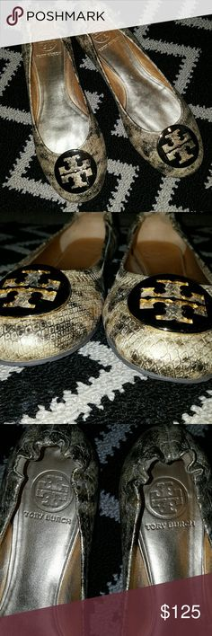 Authentic Tory Burch Reva flat, print metallic with gold emblem. Worn twice,in great condition! I don't have box because it was ruined when I was moving. Tory Burch Shoes Flats & Loafers