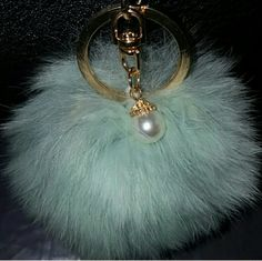 NWT MINT & PEARL keychain puff! NWT MINT color real Rabbit fur keychain pom pom charm puff OR HANDBAG accessory. Features gold hardware and white dangling pearl.  Purchase with handbag or other qualified items get at 1/2 price ([$5.00])  Price: $9.00 OR 2 FOR  $15.00!  Available in 3 colors black, mint, & grey FIRM PRICE  ❌NO TRADES ❌NO HOLDS ❌NO LOWBALLING! I WILL BLOCK YOU ⚠✔POSHMARK RULES ONLY   HAPPY POSHING!✌ queen Accessories