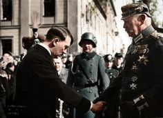 Adolf Hitler shakes hands with Paul von Hindenburg at the opening of the new Reichstag in Potsdam, March 21, 1933