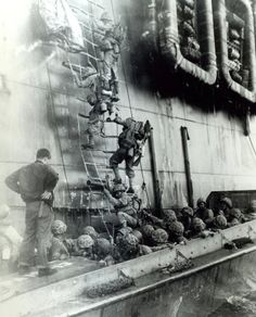 Marines climb down a debarkation ladder from a Coast Guard manned assault transport, to board an LCVP to take part in the initial attack on Okinawa, 1 April Us Marines, Okinawa Japan, Vietnam War Photos, Ice Climbing, American Soldiers, Coast Guard, Military History, Usmc, World War Two