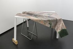 "CLEMENT VALLA The Universal Texture Recreated (46°42'3.50""N, 120°26'28.59""W), 2014 Wooden table and digital prints 33 1/10 × 55 1/10 × 39 2/5 in"