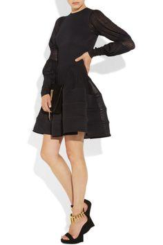 Alexander McQueen dress, Maison Martin Margiela ring, Giuseppe Zanotti shoes and clutch.