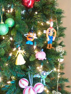 Heather Sitarzewski shares how to turn small plastic toys into festive Christmas tree ornaments. This could be a fun way to clear out the toy bins and create fun ornaments for lower branches of the. Disney Christmas Decorations, Christmas Ornaments To Make, How To Make Ornaments, Kids Christmas, Handmade Christmas, Diy Ornaments, Frugal Christmas, Ornament Tree, Christmas Projects