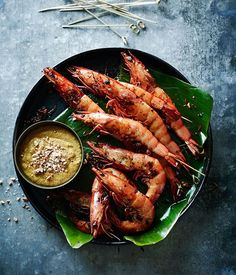 Spice up your snacking repertoire with these Asian-accented bites, perfect for Lunar New Year snacking. We have tasty meats-on-sticks such as chicken yakitori, prawn satay and Nonya pork skewers; Grilled Prawns, Grilled Seafood, Chef Recipes, Fish Recipes, Asian Recipes, Seafood Bisque, Seafood Pasta Recipes, Asian Snacks, Food Styling