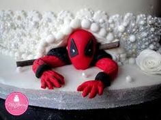 deadpool cake images   gjoqwsjco45zrpeluryk jpg   Cake   Cupcake     This is peaking out under the most awesome wedding cake