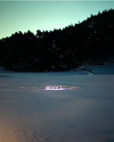 Neon love letters illuminating the evening landscape. text-based work by Korean artist Jung Lee.