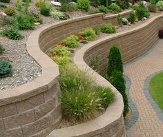 THIS IS WHAT I DREAM and WILL BUILD myself in my front yard road side... already got head start.. Terraced beds - a great way to deal with a slope!