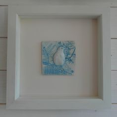 Embossed wild flower textured porcelain wall plaque with bird design (in relief). Framed. Size - plaque 13 x 13cm, white painted frame 38 x 38cm. £50.00