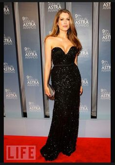 Author Tara Moss wears a Rachel Gilbert gown with Peter Lang skull jewelry to host the ASTRA awards, 2011.
