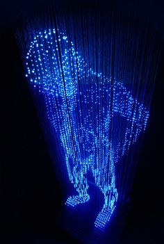 """Japanese artist, Makoto Tojiki, works with light to make his sculptures. In his collection """"The Shadow"""" (No Shadow), he stretches wire lights to create LED sculptures of people and animals. According to him, since an object is seen as our eyes catch the light reflected on them, their intention is to give way, trying to express something missing with only the light."""